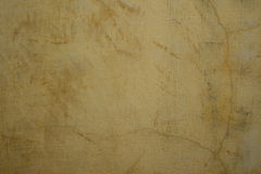 Honey colored cracked plaster wall Royalty Free Stock Photography