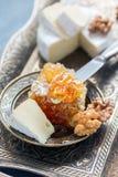 Honey comb, cheese and walnuts. Royalty Free Stock Photos