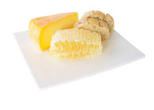 Honey comb with cheese. On white background Royalty Free Stock Photography