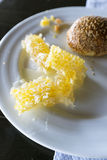 Honey comb and croissants on  plate Royalty Free Stock Image