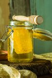 Honey with honey comb in a jar. Honey in a jar with honey comb inside Royalty Free Stock Photos