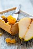 Honey comb and ripe pear. Stock Photos