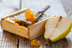 Honey comb and a slice of pear. Royalty Free Stock Images