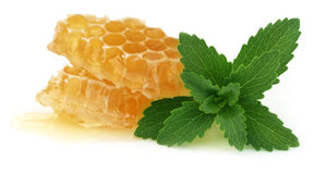 Honey comb with stevia Royalty Free Stock Photos