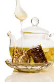 Honey comb and tea Royalty Free Stock Image