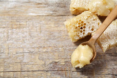 Honey with comb on wood Stock Photos