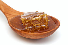 Honey comb in a woode spoon Royalty Free Stock Photos