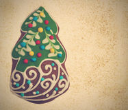Honey cookie in the shape of a Christmas fir tree wit Royalty Free Stock Photos