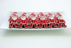 Honey Cookies auf einem weißen Hintergrund, Santa Claus formte Lizenzfreie Stockbilder