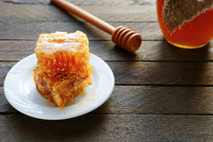 Honey in corb on wooden tabletop Royalty Free Stock Images