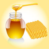 Honey current from spoon and honeycomb Royalty Free Stock Images