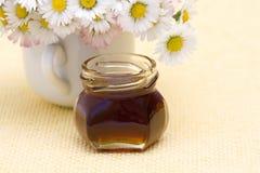 Honey and daisies Stock Photos