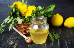 Honey with dandelion flowers and lemon Royalty Free Stock Photos