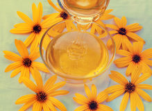 Honey decorated with flowers Stock Photography
