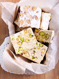 Honey and different sorts of nut nougat Stock Photos