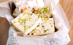 Honey and different sorts of nut nougat slices Royalty Free Stock Images