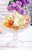 Honey and different sorts of nut nougat. Slices in a vase Royalty Free Stock Photography