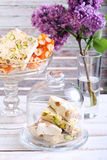 Honey and different sorts of nut nougat. Slices in a vase Royalty Free Stock Photo