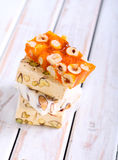 Honey and different sorts of nut nougat Royalty Free Stock Photos
