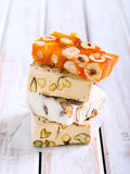 Honey and different sorts of nut nougat Royalty Free Stock Photo