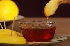 Honey-dipped apple Stock Photos