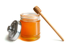 Honey with dipper Royalty Free Stock Images