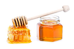 Honey with dipper Stock Photo