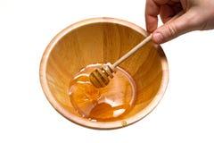 Honey on the dipper Stock Photos