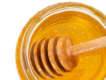 Honey with dipper closeup Stock Images