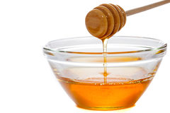 Honey  with dipper and glass bowl Royalty Free Stock Photos