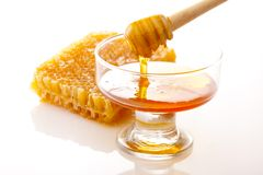 Honey dipper with honey. And honeycomb stock images