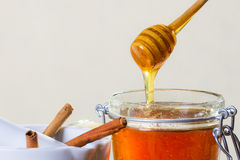Honey dipper with jar Stock Photos