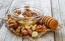 Honey and dipper selection of nuts Royalty Free Stock Images