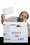 Honey Do List. Husband with a why me look when he pulls out a random chore Royalty Free Stock Photography