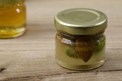 Honey with dried fruit and nut. Royalty Free Stock Images