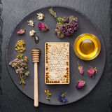 Honey and dried herbs stock images