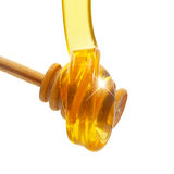 Honey drip  from wooden dipper Royalty Free Stock Photos