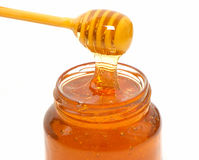Honey dripper and Honey jar isolated Stock Image