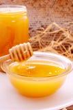 Honey dripper and jar of honey Royalty Free Stock Image