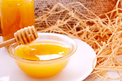 Honey dripper and jar of honey Royalty Free Stock Image