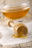 Honey dripper with some bee honey Stock Photos