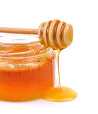 Honey dripping Royalty Free Stock Photo