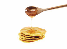 Honey dripping on breads from wooden spoon Royalty Free Stock Photography