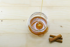 Honey dripping into a glass jar Stock Photos