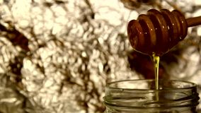 Honey dripping from a spoon stock video