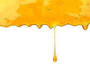 Honey dripping. Honey wooden dripping with honey dipper isolated on white background Stock Photo