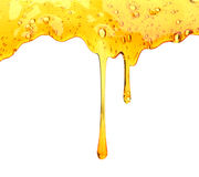 Honey dripping from wooden honey dipper stock image