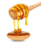 Honey dripping Stock Image