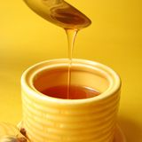 Honey drizzle. Honey drizzling from spoon stock image