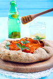 Honey drizzle over apricot pie Royalty Free Stock Photo